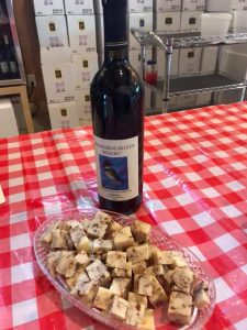 Kingfisher wine with Kalamata Olive Cheddar from Brunkow Cheese
